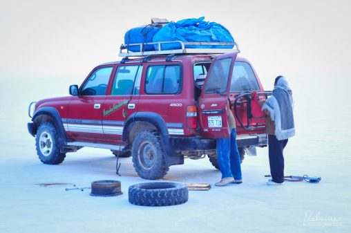Tire repair on the Uyuni Salt Flats